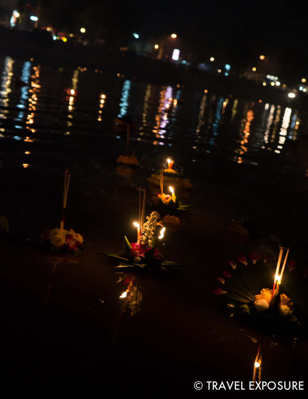 WEEK OF NOVEMBER 10 Offerings of flowers, candles and incense float on the river during the Loy Krathong Festival in Chiang Mai, Thailand.