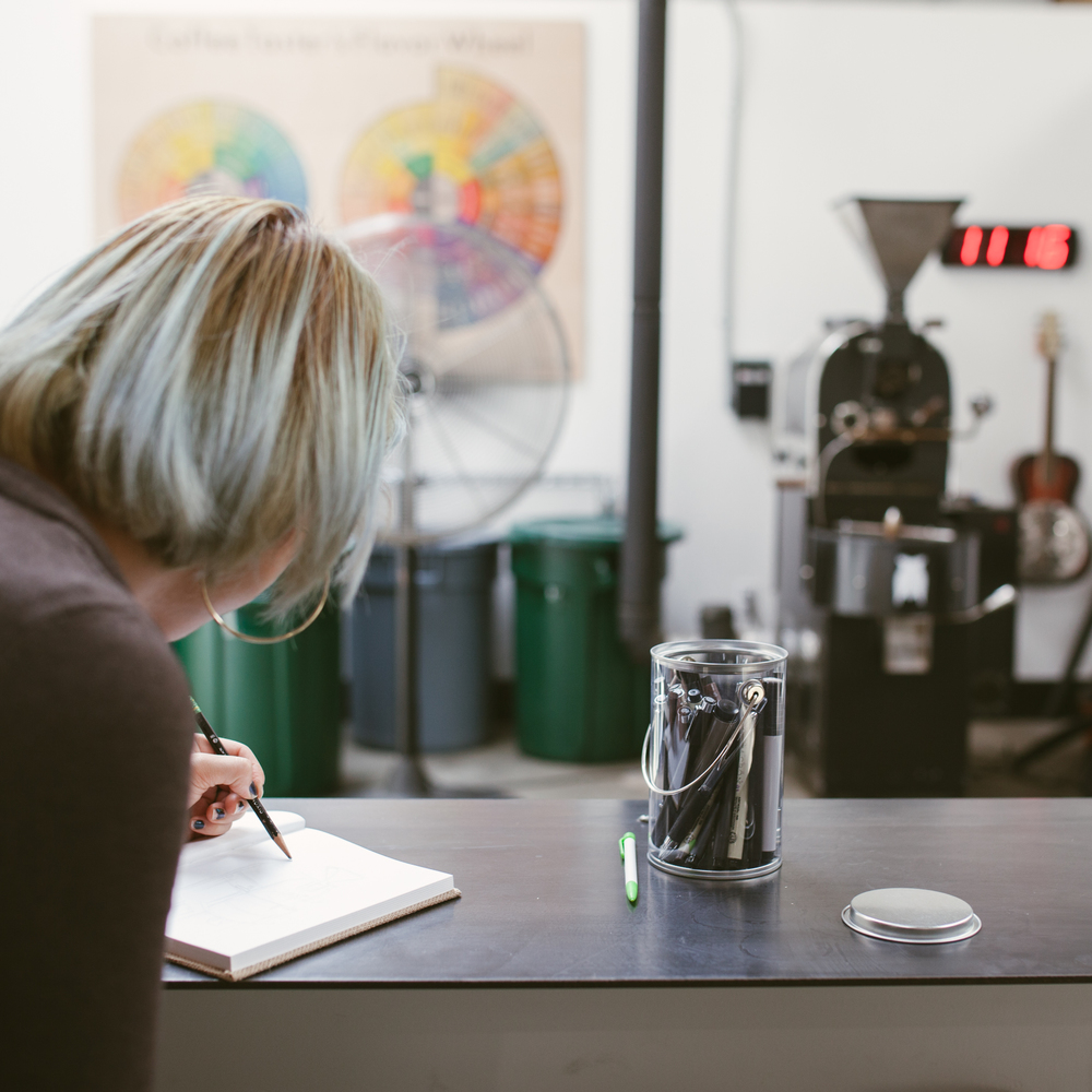 Mary sketching at James Coffee. Photo by Julie Rings. Location: James Coffee.