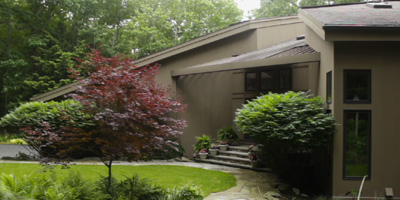 A stunning custom-built Contemporary on a private lot on Binghamton's South Mountain.