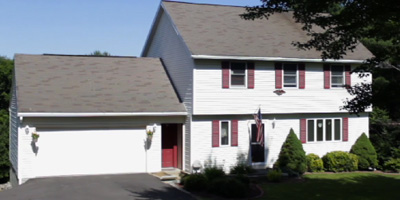 A beautiful home with contemporary spaces set on private acreage just minutes from Chenango Valley State Park.