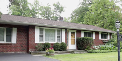 A classic brick Ranch on a private lot with room to expand!