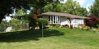 A nice Ranch on a large, rolling fenced-in lawn.