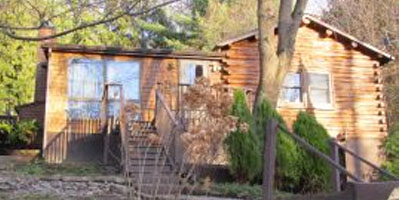 A log-cabin style home on a half-acre, close to all amenities.