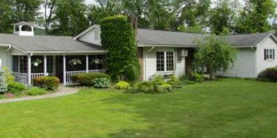 A sprawling Ranch with over 3700 square feet, a huge garage, and a lovely back yard and deck.