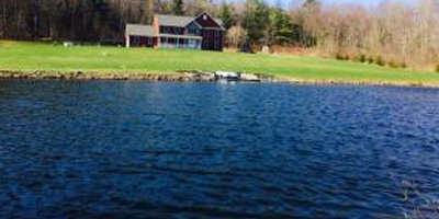 A huge country estate with 92 acres, a pond, and a newer contemporary home.