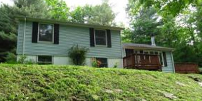 A lovely split level home on over 2 acres in beautiful country seclusion.