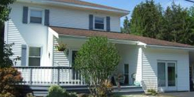 A lovely 2-story with an acre of land and an in-law apartment in outbuilding.