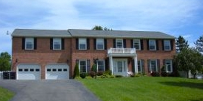 A huge brick home on over 23 acres. In-law apartment.
