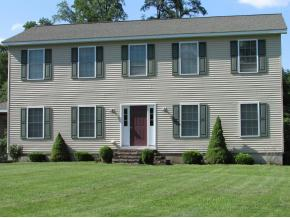 A spacious and newer Colonial on over an acre.