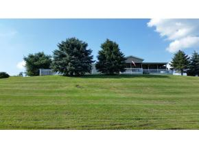 A spectacular 16 acres with large home, beautiful pond, and a fully restored and updated barn.