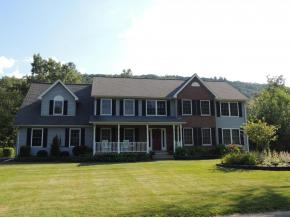A huge 7 bedroom home on over 2.5 acres along the Chenango River in Chenango Bridge.