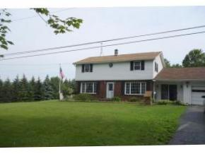 A spacious home on a lovely country lot. In-ground pool and over 1.5 acres!