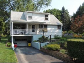 Immaculate Cape Cod with large, private park like yard.