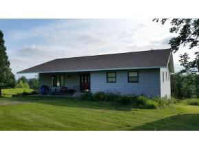 3BR Ranch with a newer roof on 22 acres with a barn.