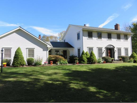 A spacious Center Hall Colonial on 5 private acres.