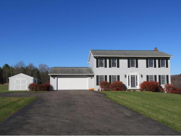A spacious newer Center Hall Colonial on acreage with beautiful views.