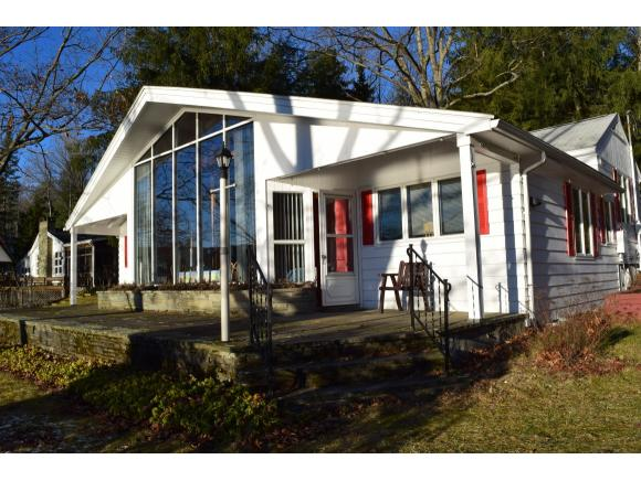 A charming Contemporary home and multi-acre property on Oquaga Lake.