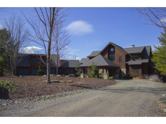 A spectacular estate featuring a unique newer home set on over 25 acres with 3 ponds.