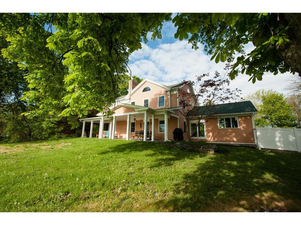 A 10 acre waterfront estate on Cayuga Lake with a large home and 2 guest houses.