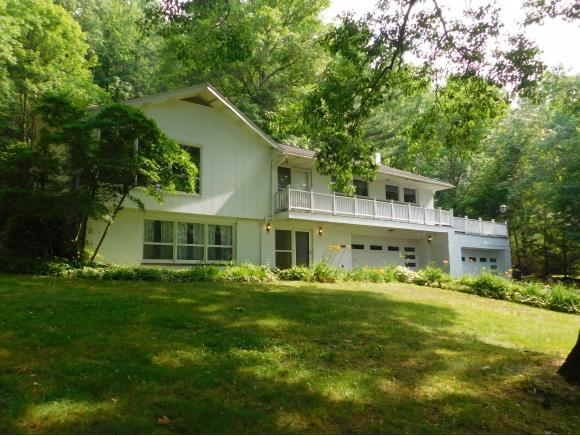 An updated spacious home with cathedral ceilings on 6.42 acres.