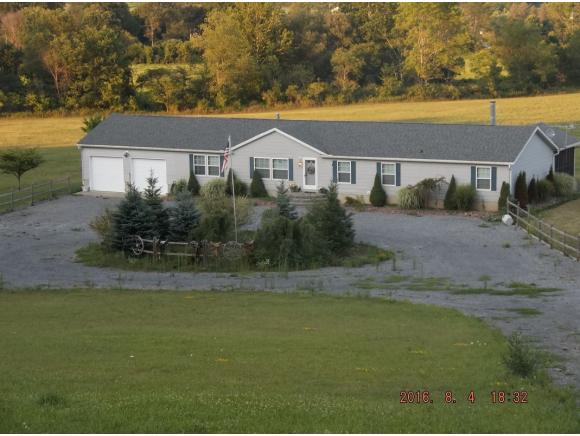 A spacious ranch on 4.5 beautiful acres with an apple orchard.