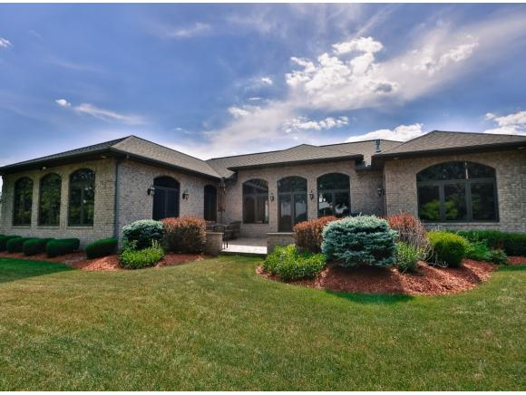 A magnificent luxury brick contemporary ranch bordering Binghamton Country Club.