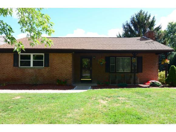 A spacious brick ranch with a newer kitchen and nice yard.