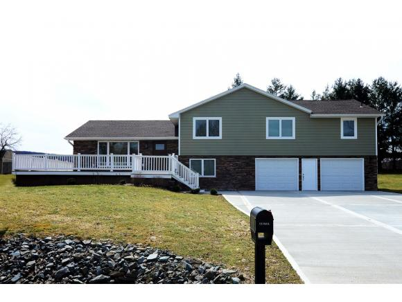 An elegantly remodeled split-level with country views.