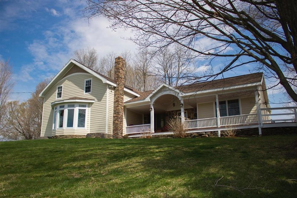 A uniquely updated and renovated home on a scenic 1.5 acre country landscape.