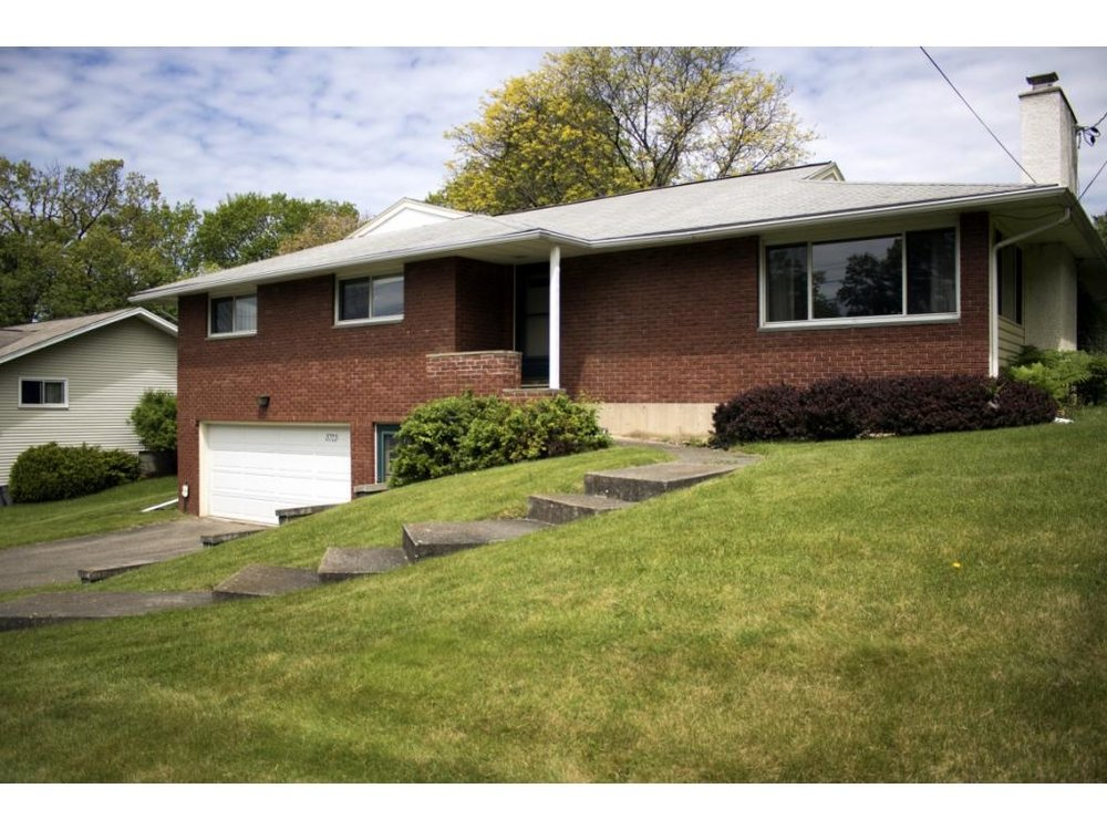 A brick Raised Ranch with a family room addition and in the Maine-Endwell school district.