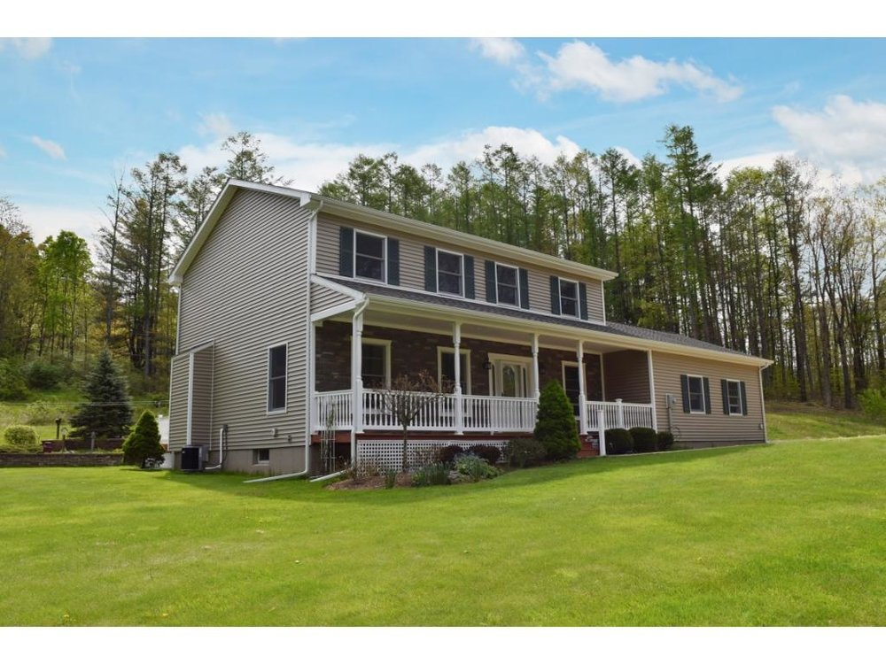 A 2-story home updated from top to bottom and set on almost 15 tranquil country acres.