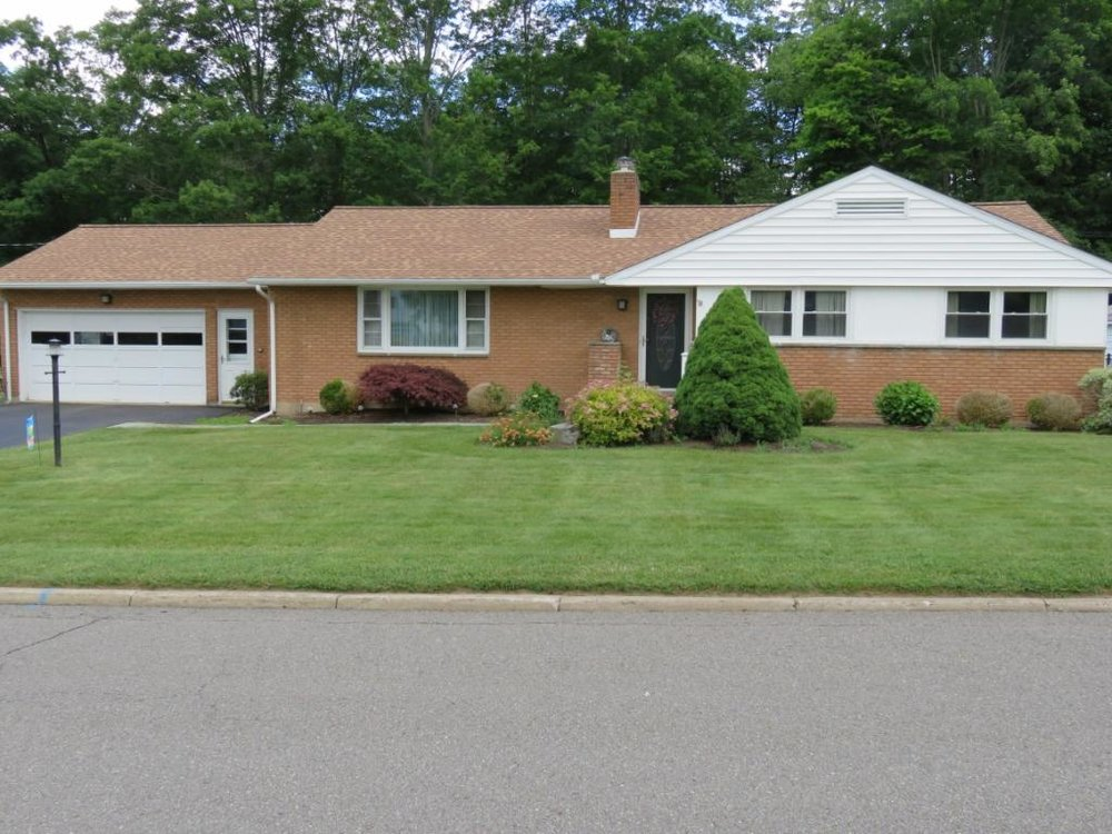 A lovely brick ranch with a brand new roof.
