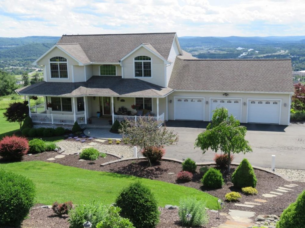 A stunning custom-built luxury home with some of the best views in the Southern Tier.