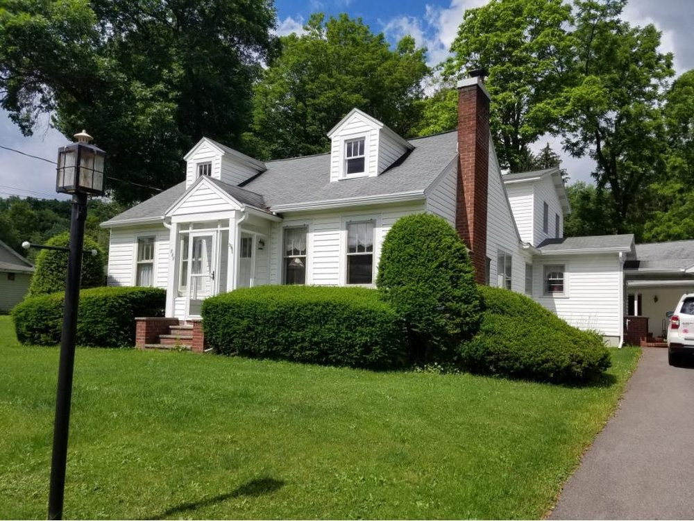 A huge Cape Cod with acreage and first-floor living.