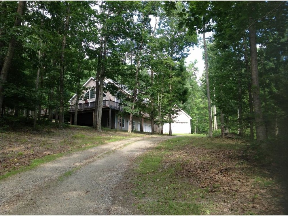 A newer Contemporary home on 4 acres with 3 levels of living.