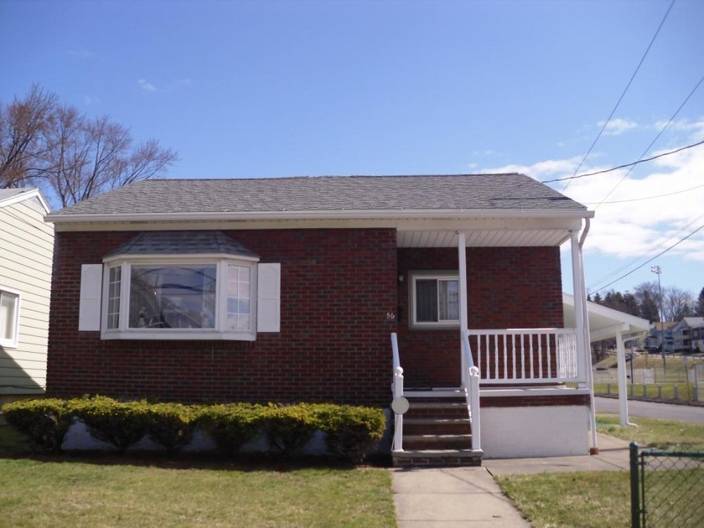 A solid brick 3 bedroom home on a corner lot across from Fairview Park.