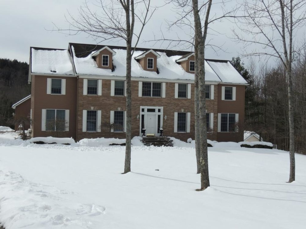 A custom-build stately brick mansion on 8.6 acres just minutes from Binghamton University.