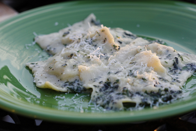 Corn ravioli in a basil cream sauce