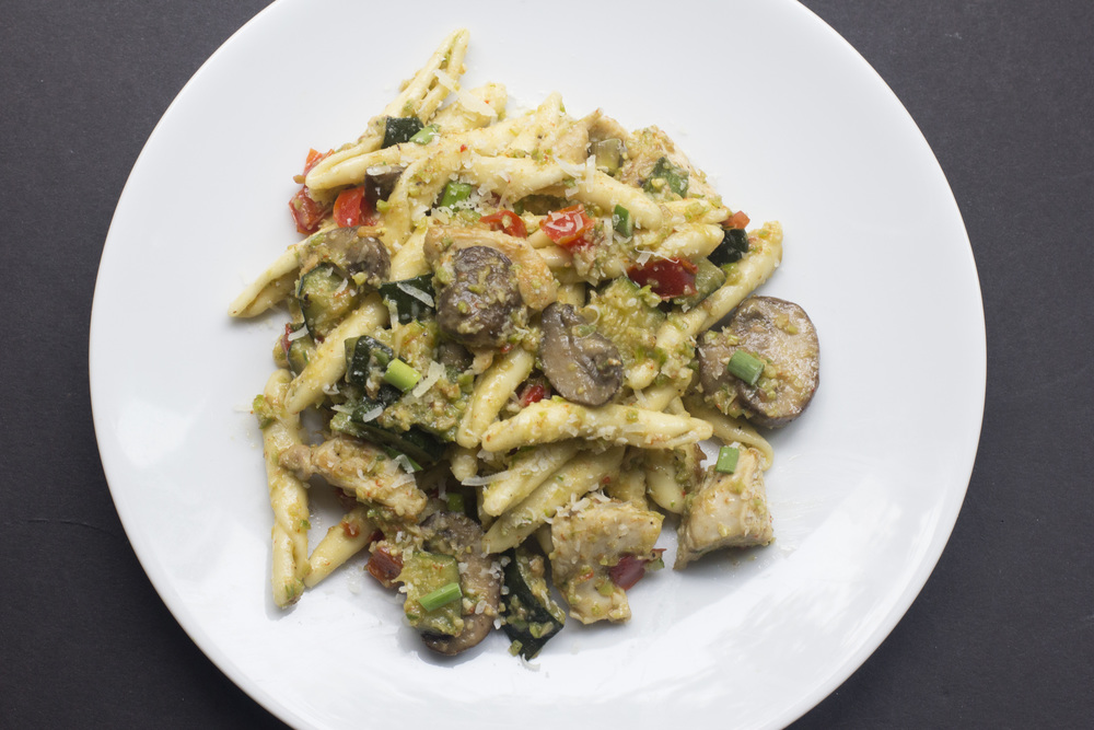 fusilli with sautéed chicken breast, mushrooms, red pepper, and zucchini, tossed in garlic scape pesto