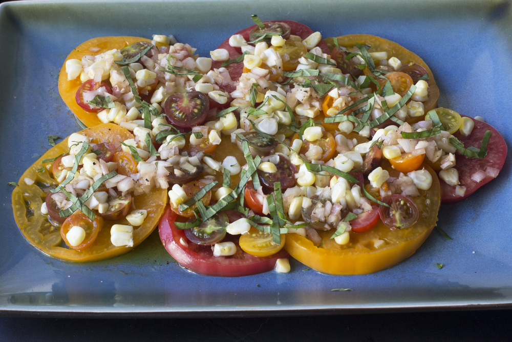 "The tomatoes I used are heirloom tomatoes from the farmer's market, but if you have access to home-grown tomatoes, no matter if they're Better Boy or Brandywine, they will be fantastic in this salad. This recipe is from Molly Wizenberg's latest book Delancey: A Man, a Woman, a Restaurant, a Marriage.  I like to call it ""Summer on a  Plate"" Salad, since it's pretty much the essence of all that is delicious and colorful this season."