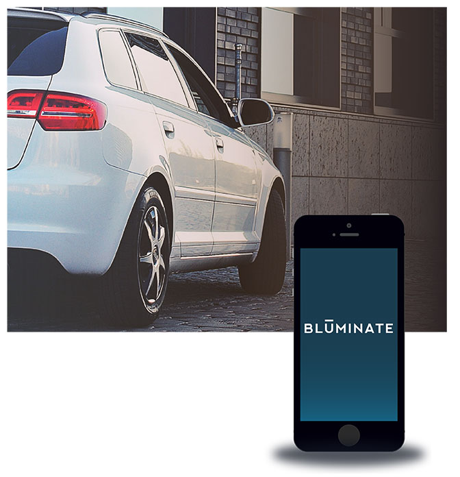 Bluetooth ® . But better. Introducing Bluminate ™  [Auto].  Picture this: you approach your car, and your car knows it's you. Your smartphone sends a Bluetooth ®  signal to Bluminate ™ , a simple intelligent device that turns your phone into a car key. As you get closer, the doors unlock. You don't have to fumble in your purse or your pocket. Meet Bluminate ™ : keyless connection for your car.
