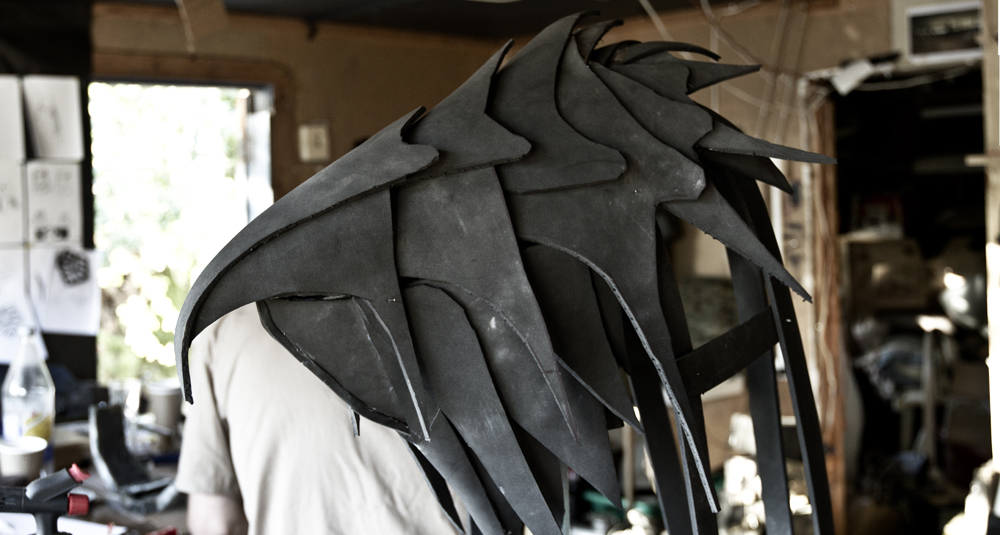 The Base of the raven head was built from EVA foam, a thinner foam to that of the armour. The mask was built in sections which clip together, modeled below by our mystery man.