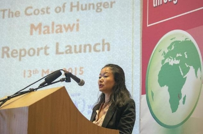 "World Food Program country representative in Malawi, Coco Ushiyama, makes remarks on May 13, 2015, during the official launch of the report ""Cost of Hunger in Malawi: The Social and Economic Impact of Child Undernutrition"" in Lilongwe ©Amos Gumulira (AFP)"