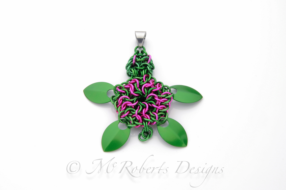 This is an original design. Originally based on the Delta Zeta sorority's pink and green turtle mascot. This is made with over 100 individual Anodized Aluminum rings.