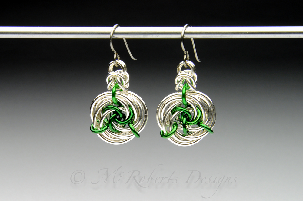 These chainmaille earrings are an original design.  I call it the Carabell Rose.  These are made with tarnish resistant Argentium Silver and Anodized Aluminum rings.  The anodized Aluminum is used to add  color to the design.