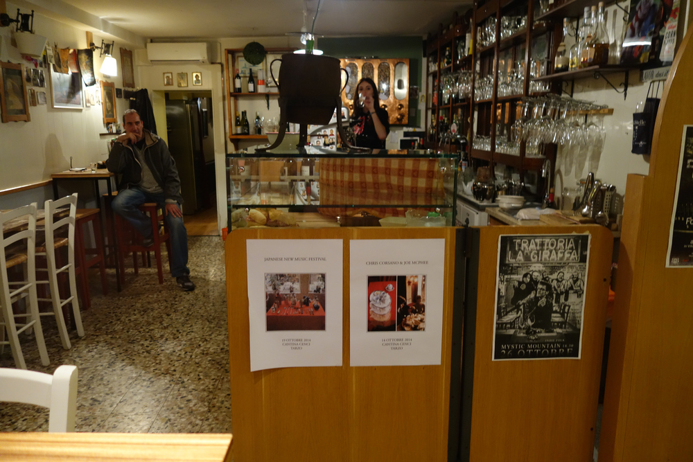 Cool bar in Vittorio; flyers for upcoming Kawabata & Corsano concerts.