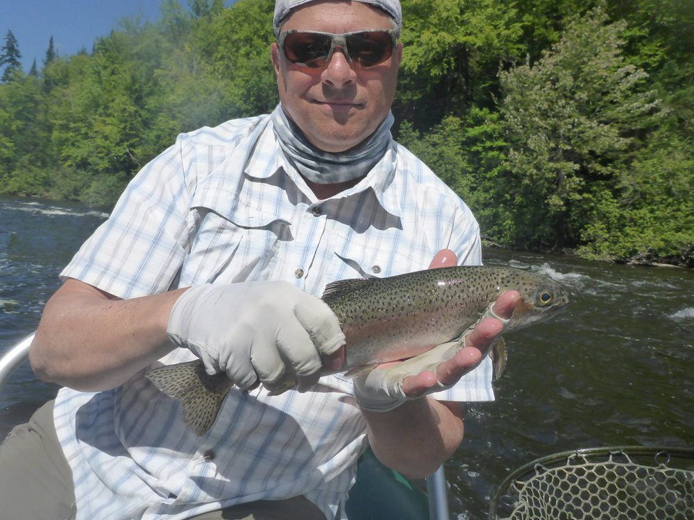 Mark Hogopian with a hot rainbow he caught nymphing a seam.