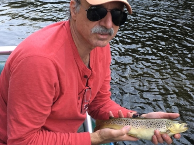 Client Mark Varveres with one of a many browns he caught while floating the Saco.