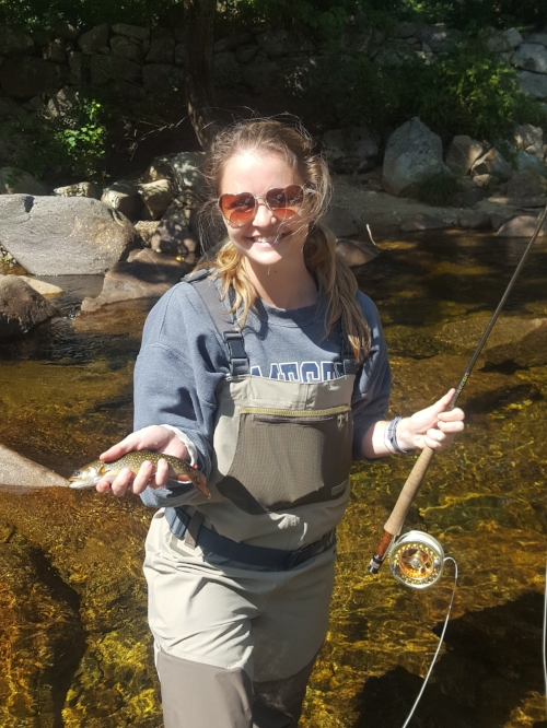 Hayley Lewis with a small stream brook trout.