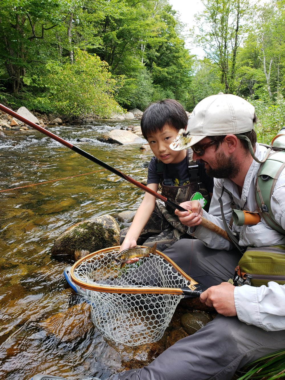 Hayden's first trout on the fly was a Buck wild brookie that ate an Elk Hair Caddis skaded using a Red brook Tenkara Rod.